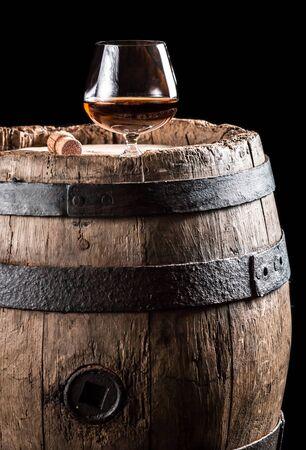 Brendy glass on old oak barrel photo