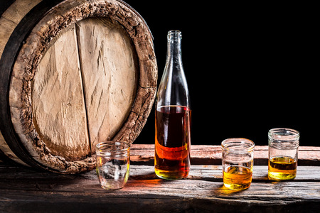 Three glass of aged whisky and bottle Stok Fotoğraf