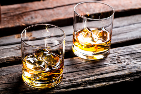 Two glasses with ice and whiskey photo