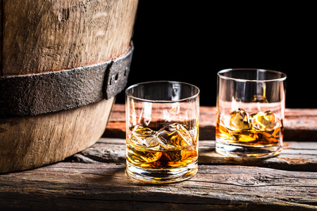 Two glasses of whiskey in the old cellar photo