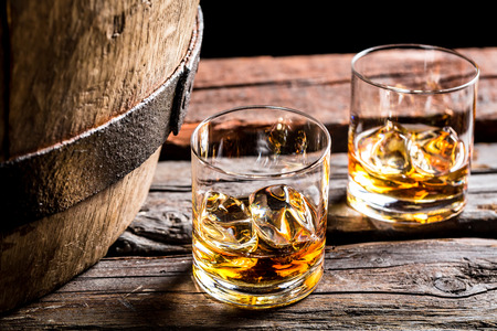 drinking alcohol: Glass of whiskey in the old cellar