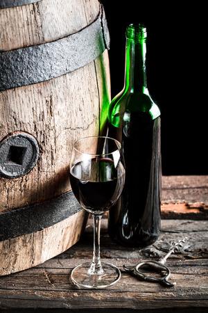 oak barrel: Wooden oak barrel and a glass of Wine Stock Photo
