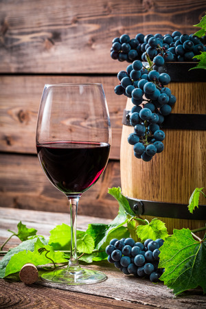 demijohn: Red grapes and a glass of red wine Stock Photo