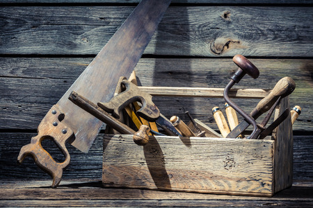 carpenter tools: Old wooden carpenters box with tools