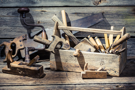 Wooden carpenters box with tools Stock Photo