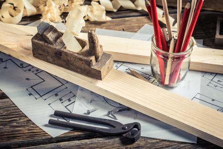 Drawing workshop and vintage carpentry workbench Foto de archivo