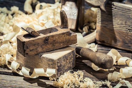 wood planer: Planer, piece of wood and sawdust Stock Photo