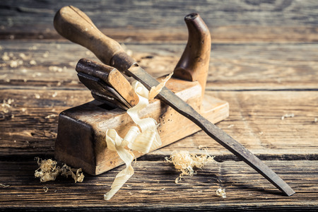 carpenter's sawdust: Old chisel and planer in a carpentry workshop Stock Photo