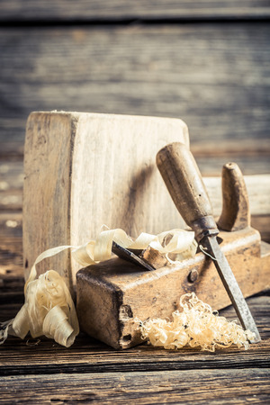 planer: Wooden hammer and planer on wooden table