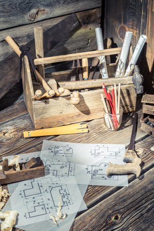carpenter's sawdust: Wooden drawing desk in carpenter workshop