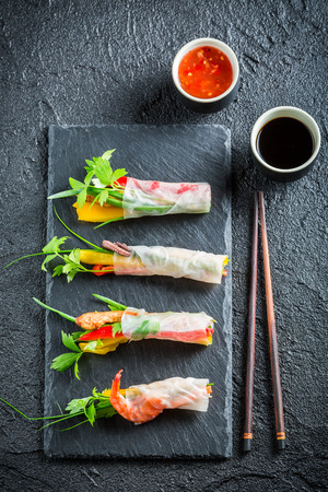 Few spring rolls with vegetables and sauce photo