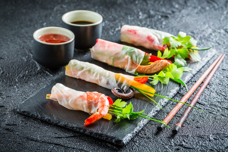 Spring rolls with vegetables, seafood and sauce Foto de archivo