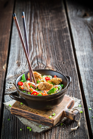 chinese dinner: Chicken with sesame with vegetables and noodles Stock Photo