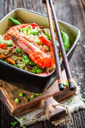 Traditional asian dish with shrimp and noodles photo