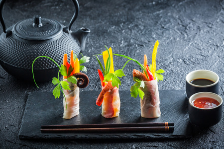Fresh spring rolls with vegetables and seafood photo