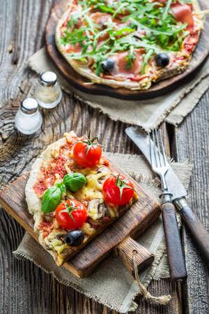 sprinkling: Sprinkling flour on fresh pizza dough Stock Photo