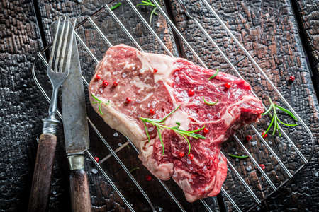 Fresh piece of beef with herbs photo