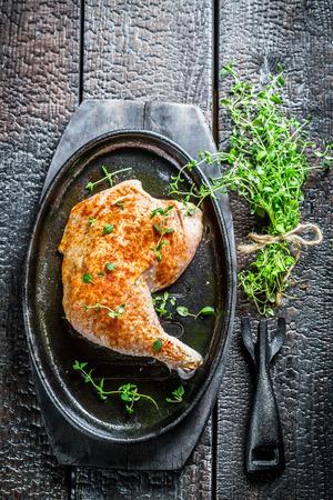 Piece of chicken with fresh marjoram photo