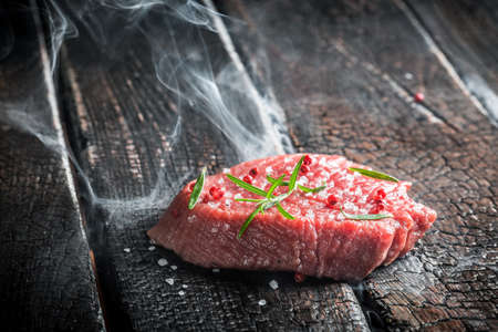 Roasting fresh steak with herbs photo
