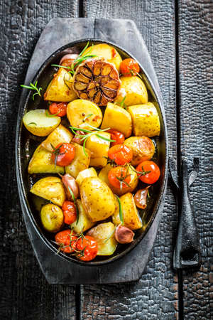 grilled potato: Grilled potato with rosemary and garlic Stock Photo