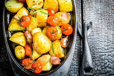 grilled vegetables: Roasted potato with fresh tomato and garlic