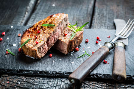 Hot roasted beef with fresh rosemary ready to eat photo
