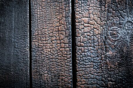 Closeup of burnt wooden background