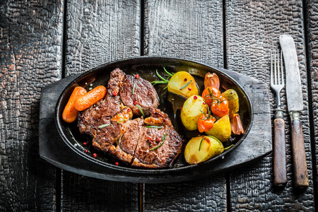grilled vegetables: Roasted steak and vegetables with herbs on grill