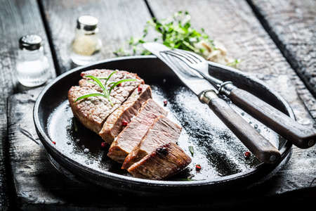 Hot beef with fresh herbs on plate photo