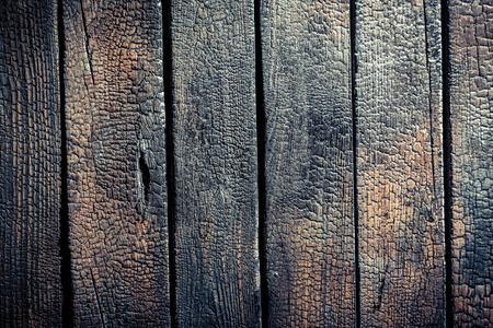Zwarte verbrande houten hek Stockfoto