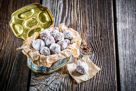 chocolate balls: Sweet chocolate balls with powder milk in old box
