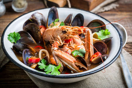 Seafood soup with mix of shellfish Stock Photo
