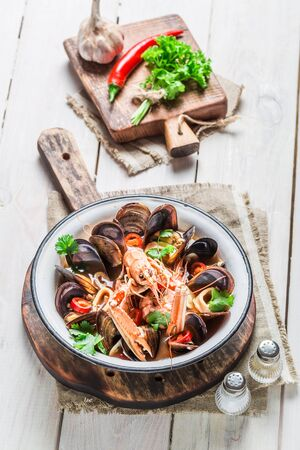seafood soup: Tasty seafood soup with mussels and shrimps