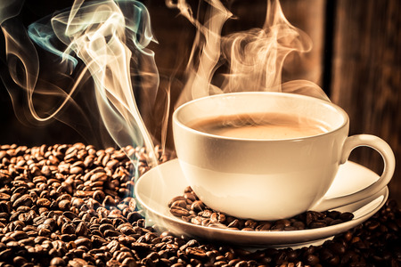 Attar: cup of coffee with roasted seeds Stock Photo