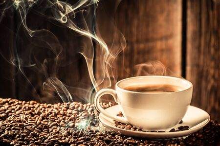 attar: cup of coffee with roasted grains Stock Photo