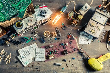 electronics parts: Vintage electronics parts on work desk in school lab Stock Photo