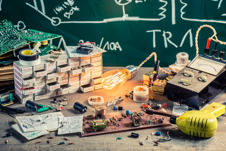 electronics parts: Old electronics parts on workshop in laboratory Stock Photo
