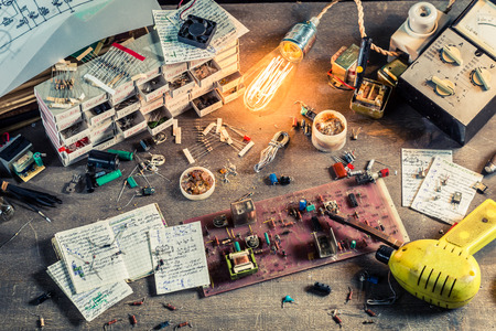 electrical engineering: Old electronics parts on workplace in laboratory Stock Photo