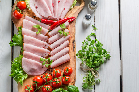 Smoked cold cuts with pepper and herbs