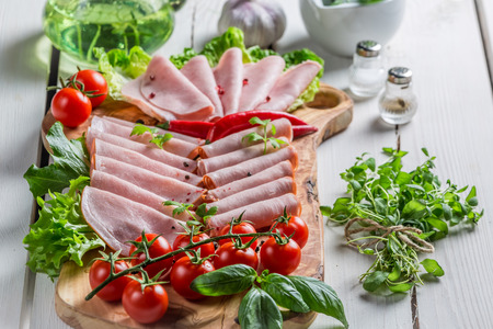 meats: Smoked cold meats with herbs and pepper
