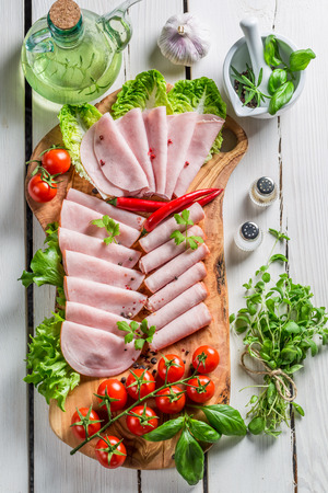 meats: Smoked cold meats with pepper and herbs