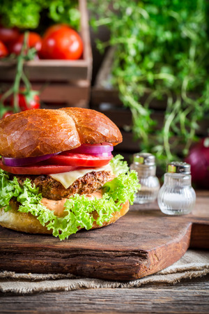 Homemade burger with vegetables photo