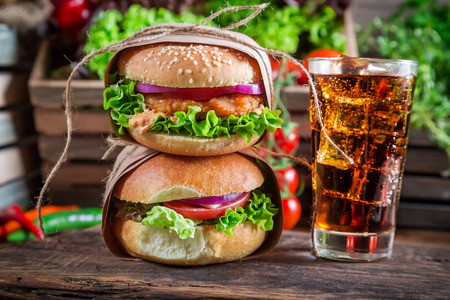 Takeaway fresh hamburger with cold drink photo