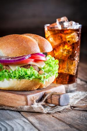 Cold drink with tasty hamburger photo