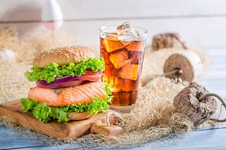salmon fishery: Fresh burger with fish  served with cold drink Stock Photo
