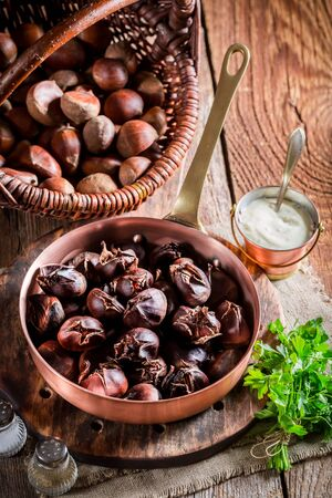 Roasted chestnuts  with garlic sauce photo