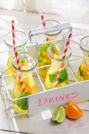 Summer lemonade with citrus fruits photo