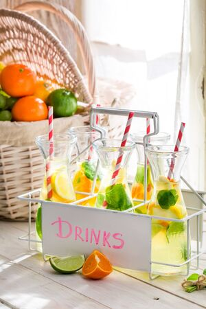 Summer drink with citrus and mint leaf photo
