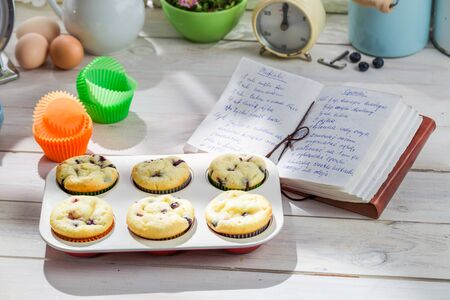 Decorating tasty muffins with sweet cream photo