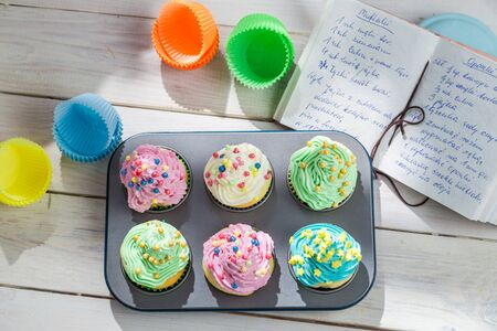 Preparation for tasty cupcakes with sweet cream photo